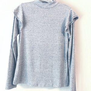 Gray mock turtleneck with ruffle shoulder